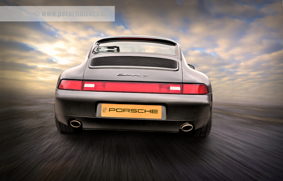 Porsche Carerra rear view portrait.