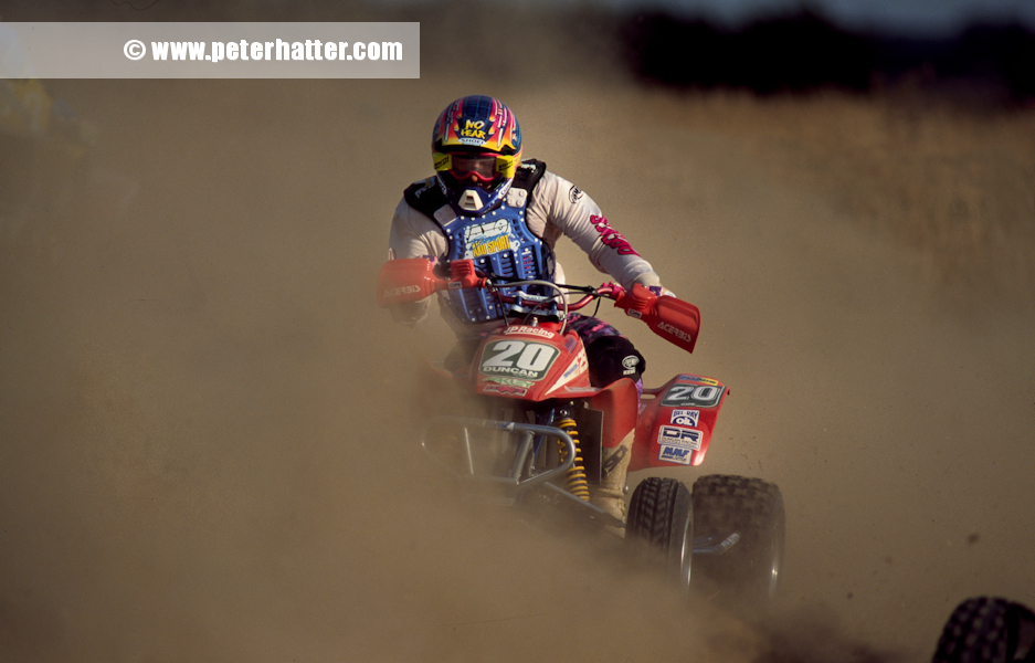 quad bike racing through the dust