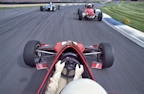 pov single seater racing car on track